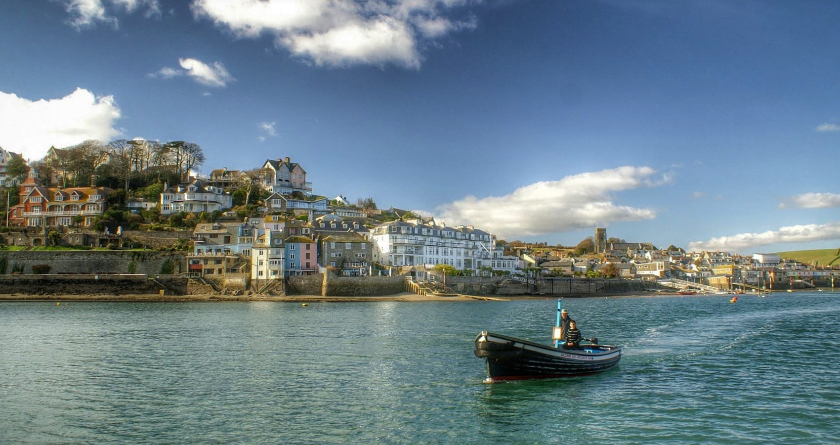 Fishing boat on estuary with Salcombe in the background